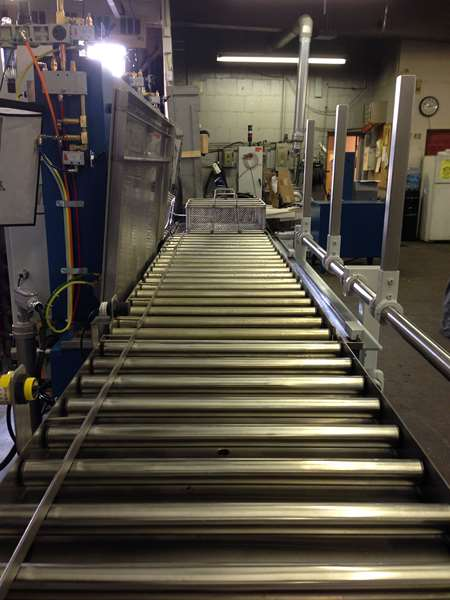 Automated immersion parts washer - roller conveyors